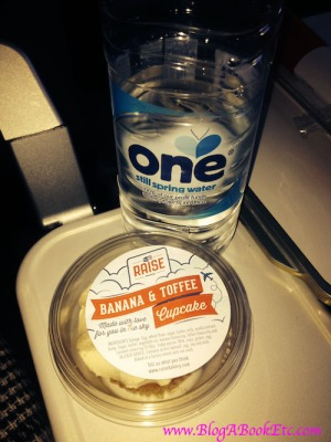 water and cake on the plane